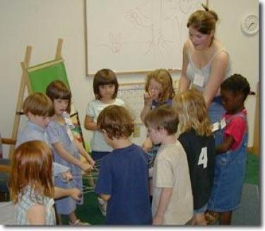 Teacher with students learning about sustainibilty