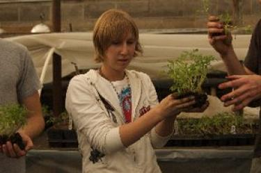 Student with garden plant