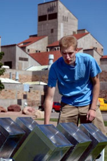 Student working with solar panels