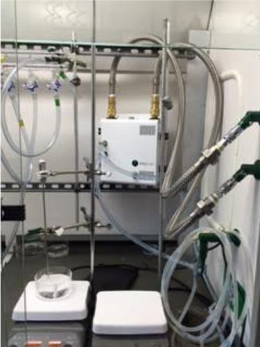 recirculator that uses building processed chilled water inside a fume hood