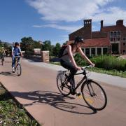 student riding bike near UMC