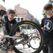 bike mechanics work on a mounted bike