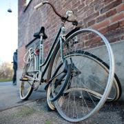 photo of an old abandoned bike with missing tire