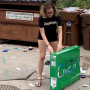 A student prepares a box for recycling