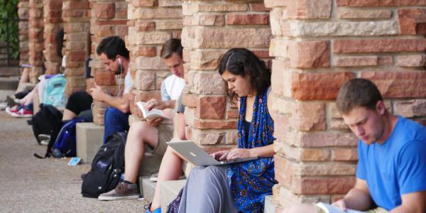 Students sitting outside UMC studying