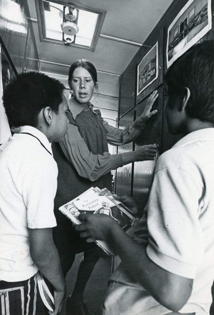 Reading Specialist Mary Dwyer showed students some of the equipment and materials—such as books, films, projectors and testing equipment—to be shared with Colorado classrooms and teachers. (Daily Camera Collection, CU Heritage Center)