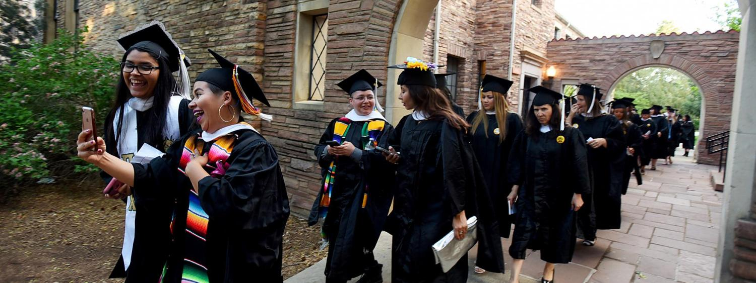 Graduates walking to commencement