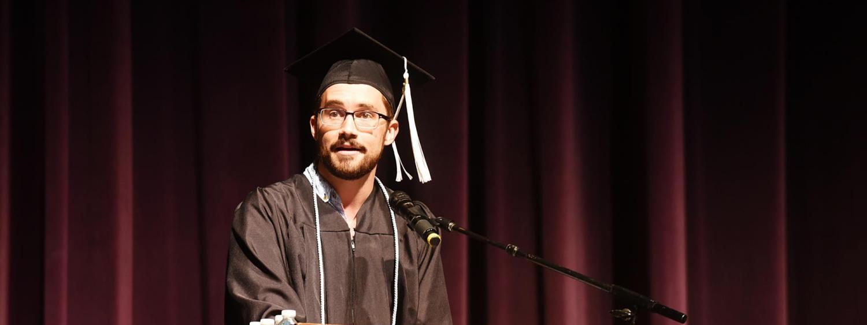 Tyler LeCroy speaking at graduation