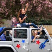 A graduate from Centaurus High School celebrates in a car parade in May 2021. (Credit: Glenn Asakawa)