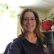 Holly Mayer-Gates smiling in her office