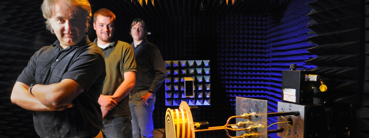Dejan Filipovic and two of his grad students pose in their antenna test chamber