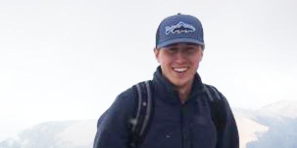 daniel broe standing on mountain top