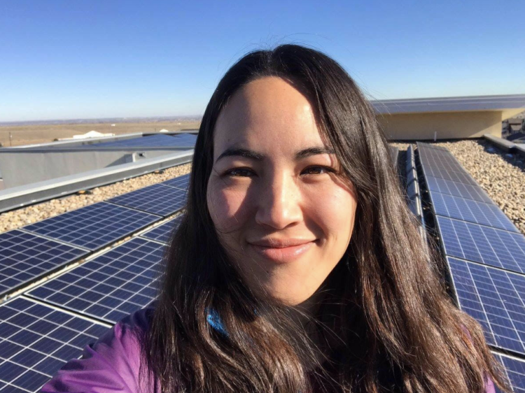 Kyri Baker selfie in front of solar panels