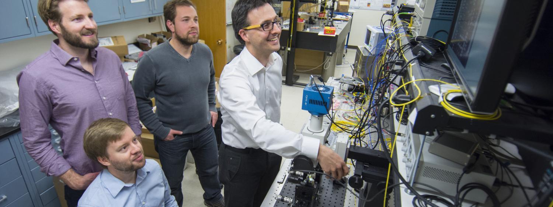 Milos Popovic teaching students in optics lab