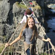 Gabriel Kassadi on a rope bridge