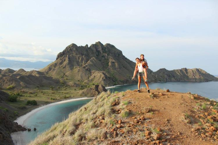 Kiki Garthwaite (TAM) and Elise Brizes (ChemBio) summit Palau Padar in Komodo National Park, Indonesia