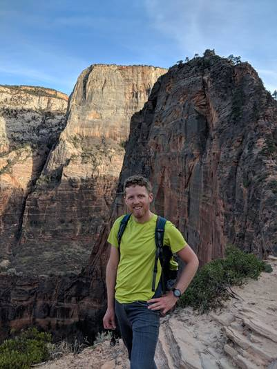 Andrew Kramer outside in a canyon