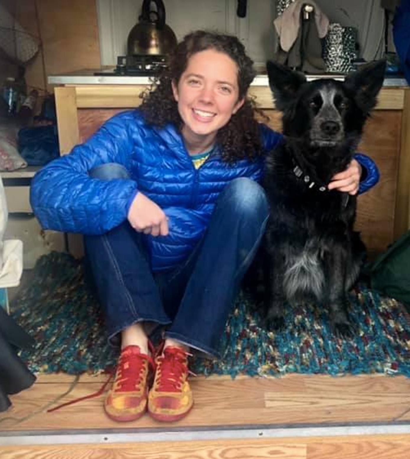 Abbie Weeks in her converted camper van with her dog