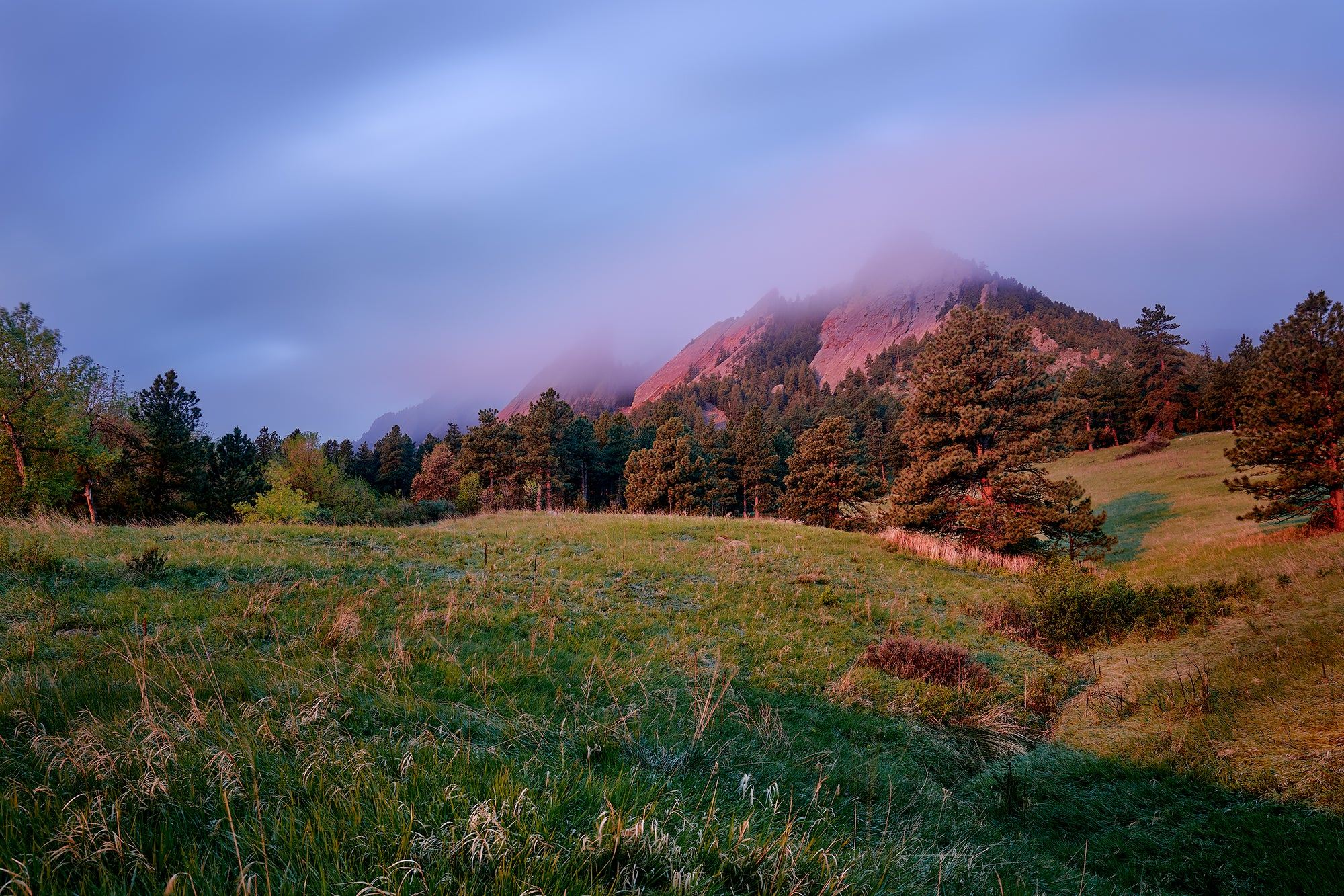 """Shimmer"" by Kent Burkhardsmeier, showing clouds over the Flatirons"