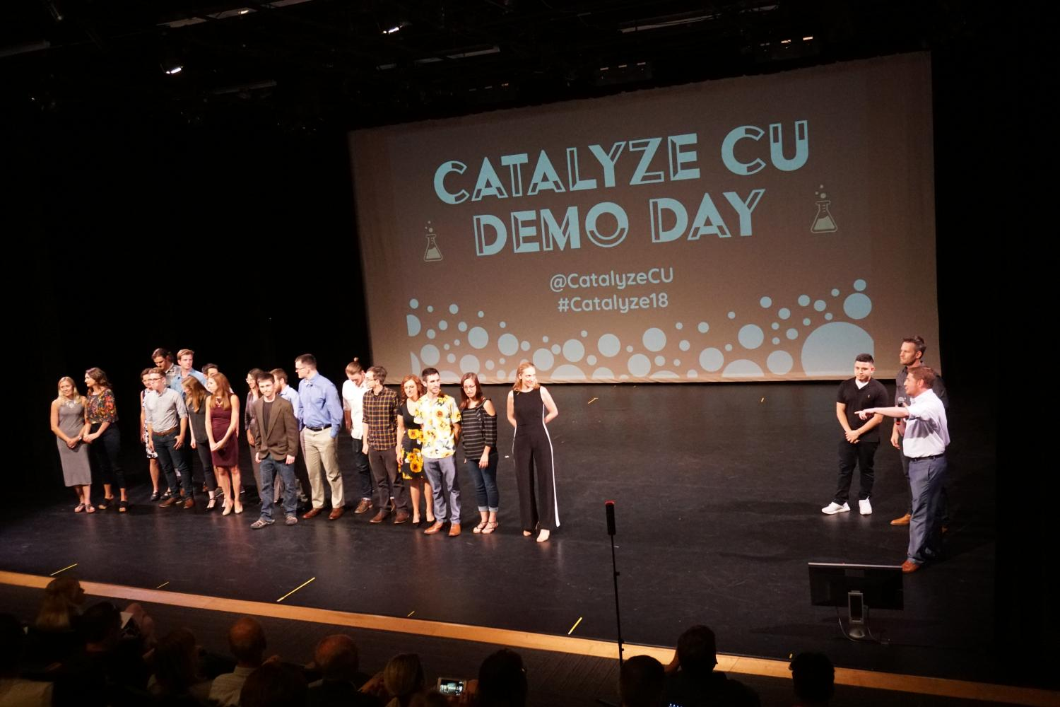 The Catalyze founders line up on stage after giving their final pitches.