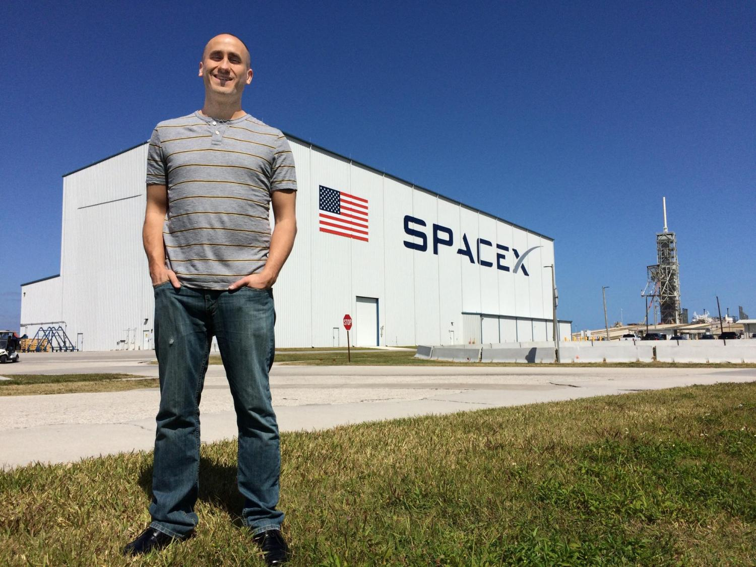 Sam Piper, aerospace engineering student at CU spearheaded the hardware development effort for the Micro-11 experiment. Launchpad 39A on the background (this is one of the two launchpads used during the Apollo and Space Shuttle programs and is now leased by SpaceX).