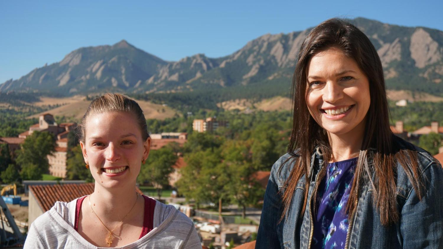 Stacy Hayes and Jennifer Perot with flatirons in background