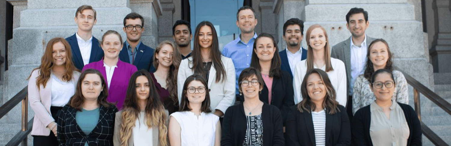 Policy fellows standing on steps