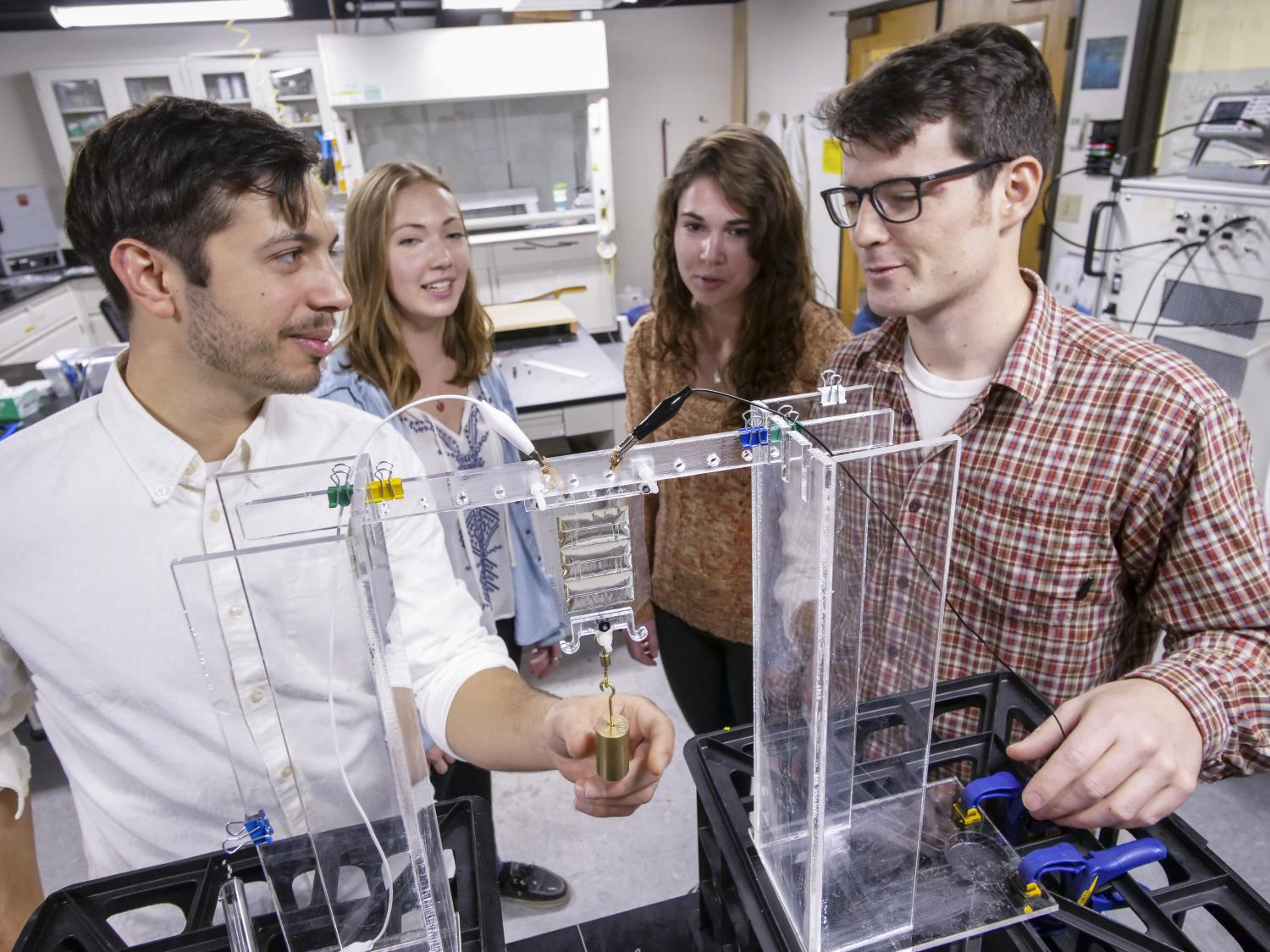 Students work in mechanical engineering lab with artificial muscles