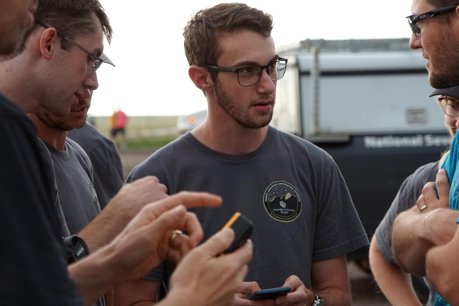 Students talking between deployments of the drone