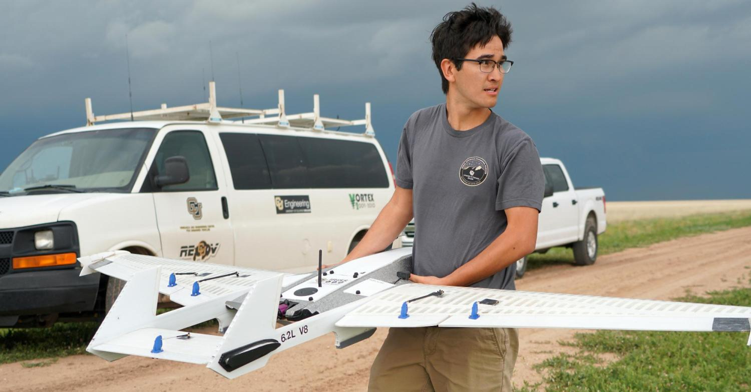 A student getting ready to launch a drone