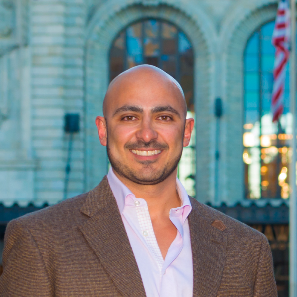 Marco Campos in a brown blazer