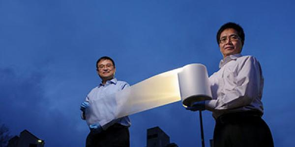 Ronggui Yang and Xiaobo Yin hold a roll of their cooling material.