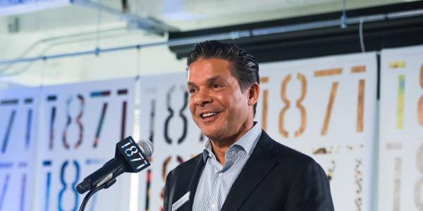 David Gupta speaks at an event.