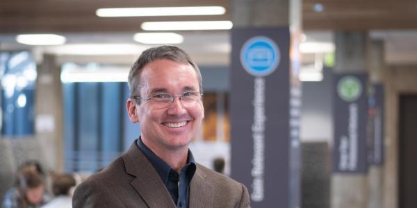 Keith Molenaar portrait in the lobby of the engineering center