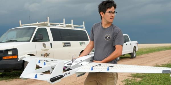 Student getting ready to deploy a drone