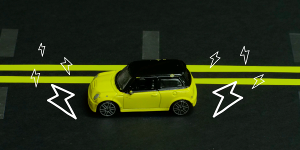 """An illustration of a car traveling down the """"charging lane"""" of a roadway."""