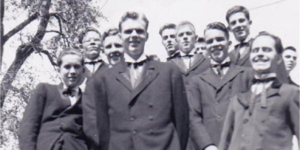 Students in suits standing on a staircase