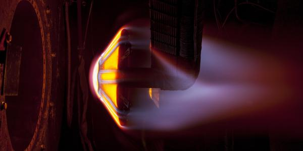 The Arc Jet Complex at NASA's Ames Research Center in California's Silicon Valley conducts heat simulation testing on a conceptual heat shield prototype.