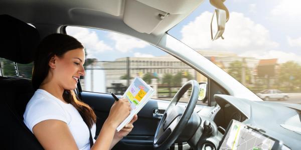 Woman in autonomous car