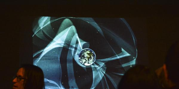 A screen showing an abstract image during the 2017 ATLAS Expo.