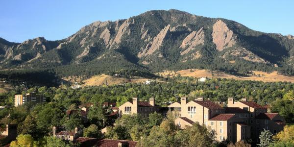 The Flatirons with the CU Boulder campus in the foreground.