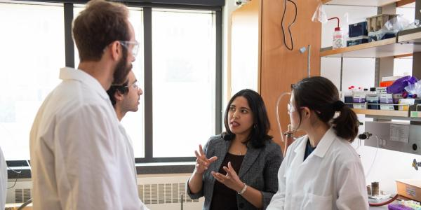 Chatterjee talking to a student group
