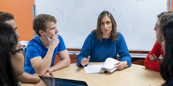 Associate Professor Claire Monteleoni with grad students