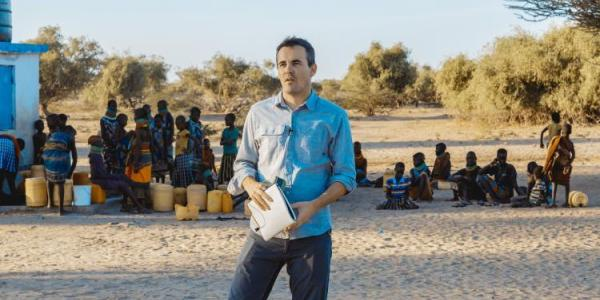 Researcher speaking in Africa
