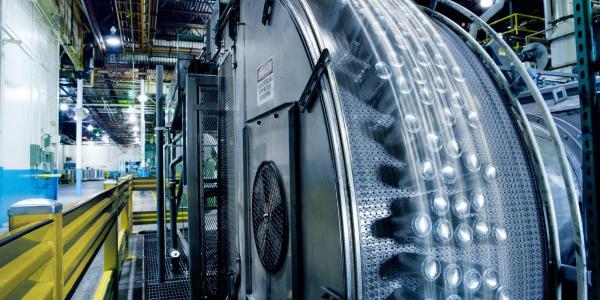 Ball canning operations machine