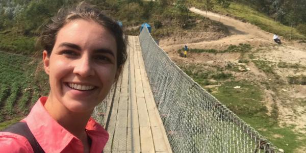 Sally Gerster in front of a footbridge in Rwanda.