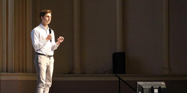 Dean Eyolfson of Magneta presents on stage