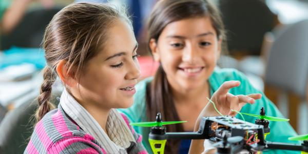 CU Engineering offers programs for K-12 teachers and students. Pictured are two middle school young girls exploring an unmanned aerial vehicle.