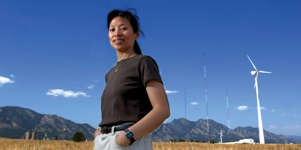 lucy pao, cu boulder faculty at national research lab in front of windmills