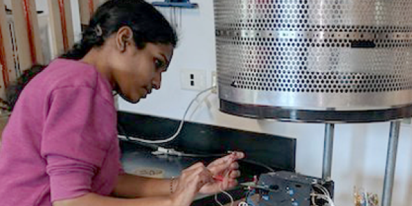 Students testing a student-built instrument that will be flown on a CubeSat.